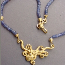18kt Gold Octopus Necklace on Tanzanite Beads and Emerald Drop