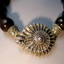 Sterling Silver Ammonite Clasp on Garnet Bead Bracelet
